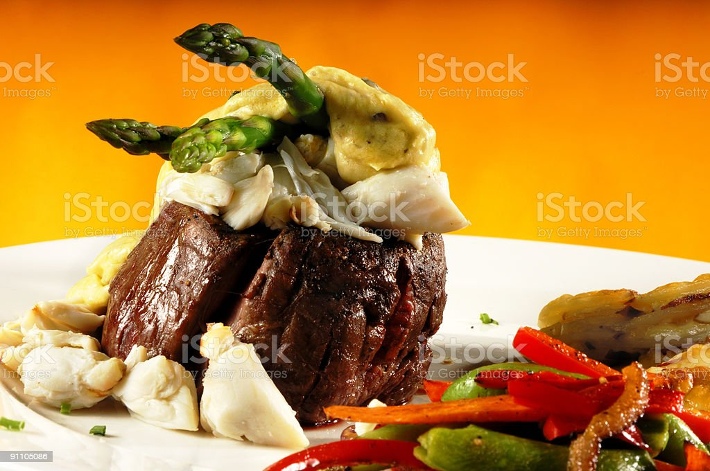 Fillet Mignon with Crab Meat and Vegetables stock photo
