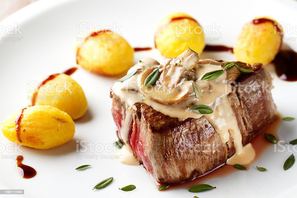 Fillet of beef with mushroom sauce and potatoes stock photo