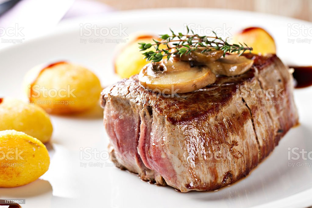 Fillet of beef with mushroom sauce and potatoes royalty-free stock photo