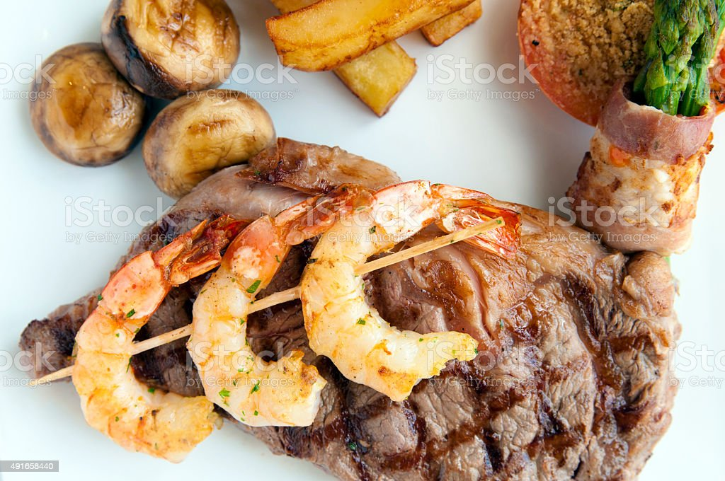 Fillet of beef with mushroom, shrimps, sauce and potatoes stock photo