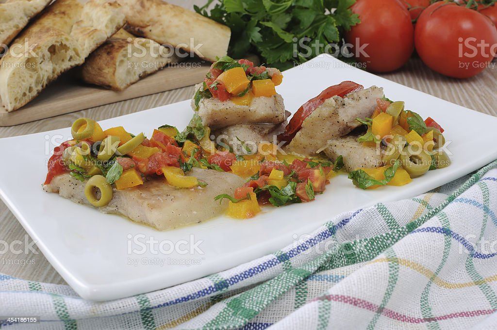 Fillet of fish under vegetables royalty-free stock photo