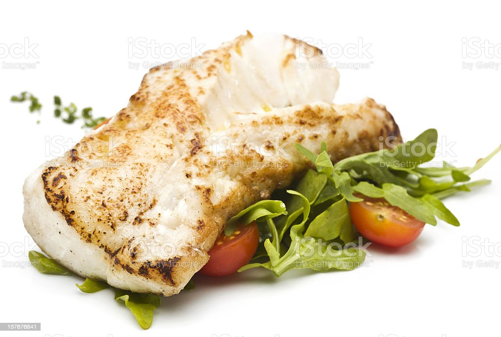 Fillet of fish with green salad stock photo
