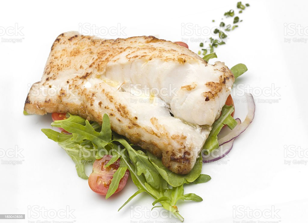Fillet of fish with green salad royalty-free stock photo