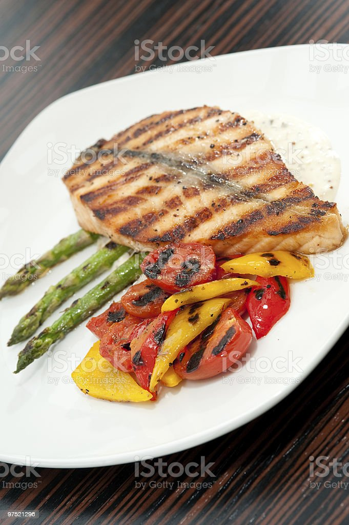 Fillet of grilled fish on asparagus royalty-free stock photo