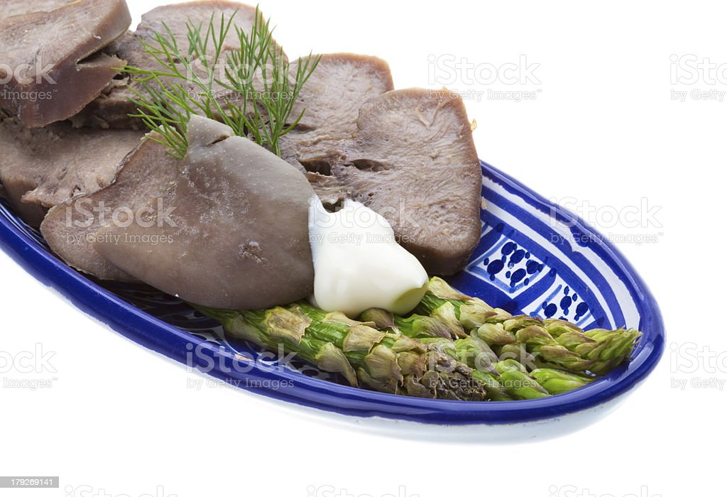 Fillet of pork tongue with asparagus royalty-free stock photo