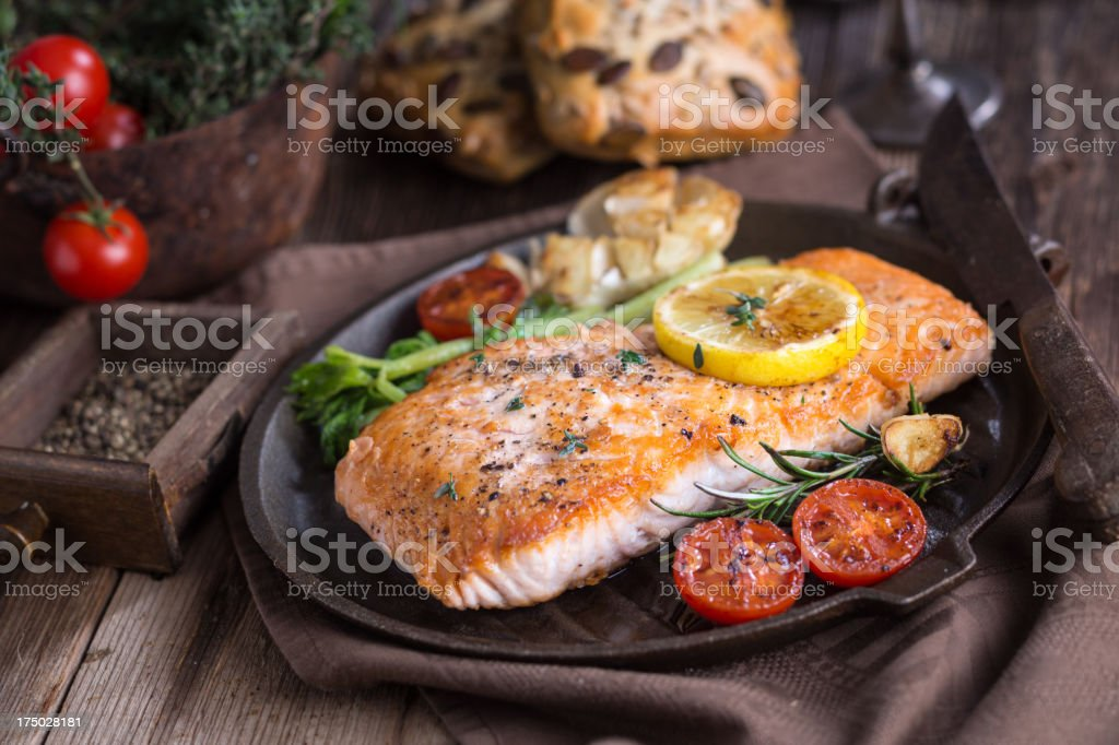 Fillet of salmon with vegetable Fillet of salmon with vegetable. Cooking Pan Stock Photo
