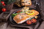 Fillet of salmon with vegetable.