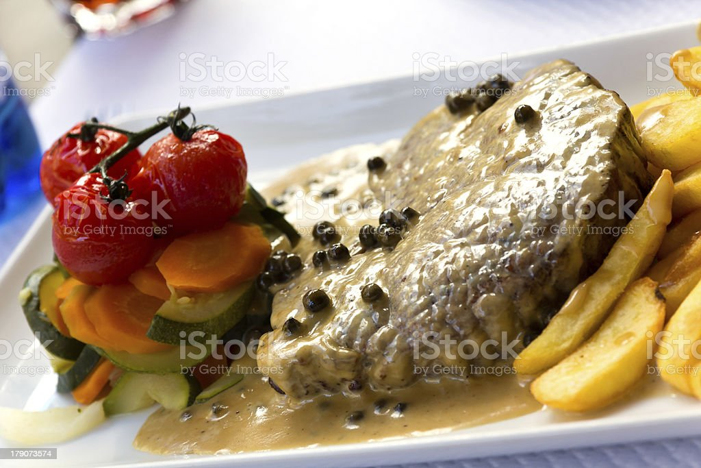 Fillet Steak with French Fries and Pepper Cream Sauce stock photo