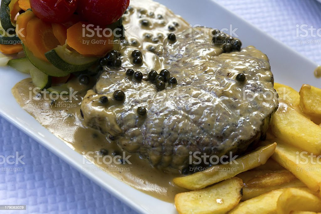 Fillet Steak with French Fries and Pepper Cream Sauce royalty-free stock photo