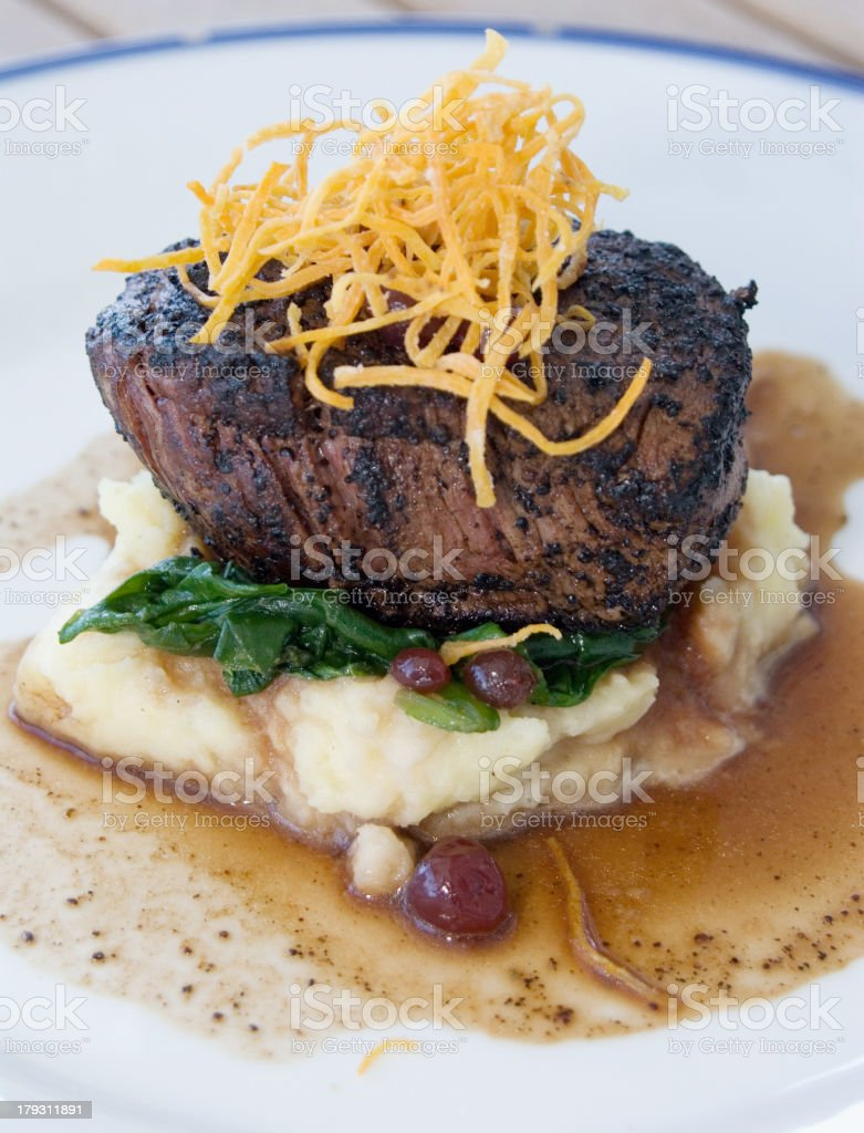 Fillet Steak with mashed potato, spinach and gravy royalty-free stock photo