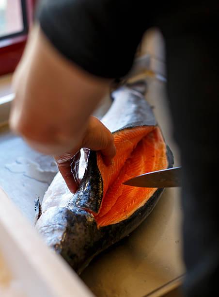 Filleting salmon. stock photo