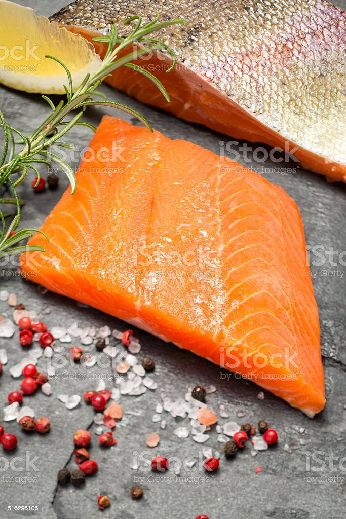 Fillets of Rainbow Trout on a Slate Background stock photo