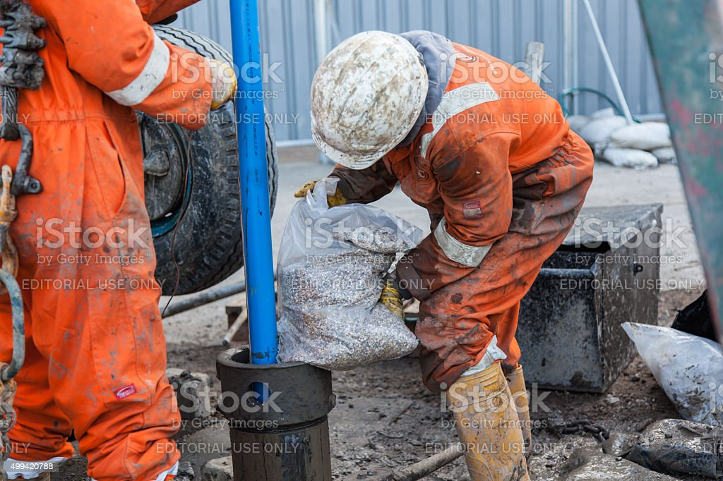Filling a Borehole with aggregate stock photo