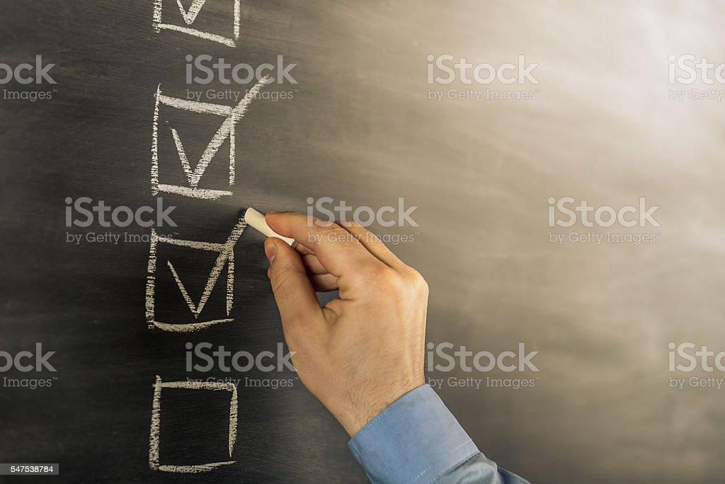 filling a checklist bildbanksfoto
