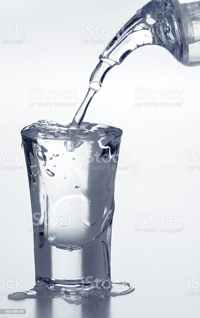 Filling a shot glass royalty-free stock photo