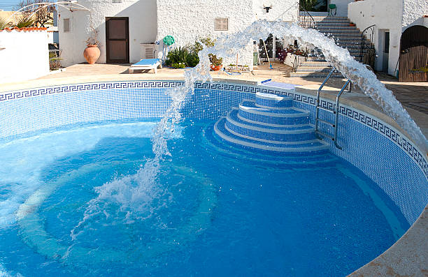 Filling a swimming pool with water stock photo