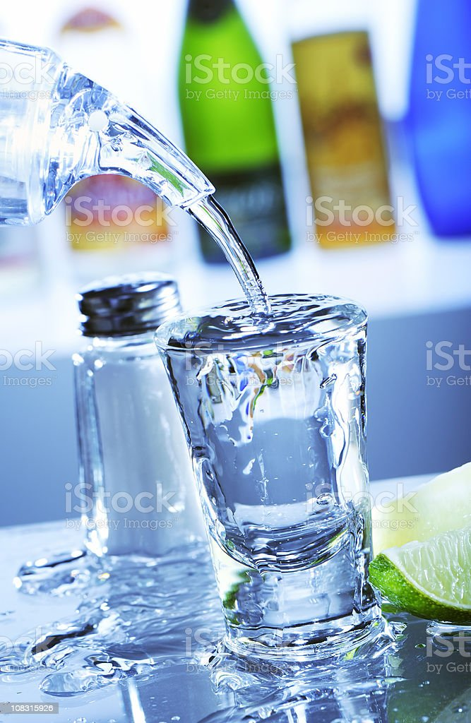 Filling a tequila shot royalty-free stock photo