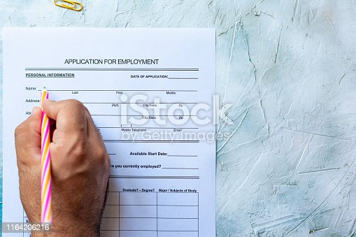 636681940istockphoto Filling application form for job 1164206216