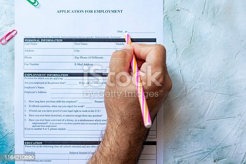 636681940istockphoto Filling application form for job 1164210890