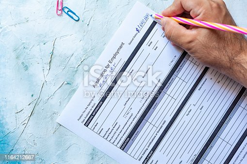 636681940istockphoto Filling application form for job 1164212667