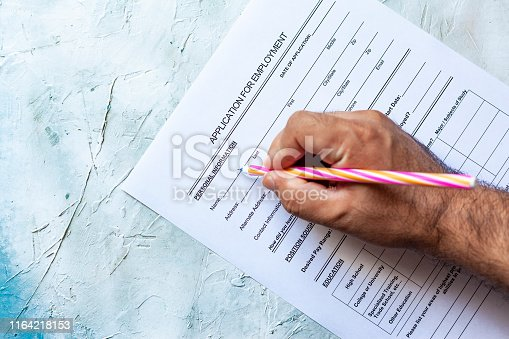 636681940istockphoto Filling application form for job 1164218153
