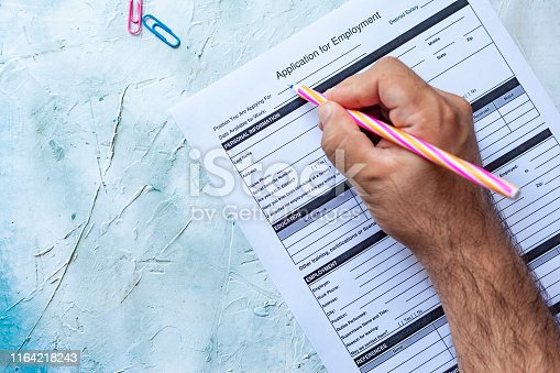 636681940istockphoto Filling application form for job 1164218243