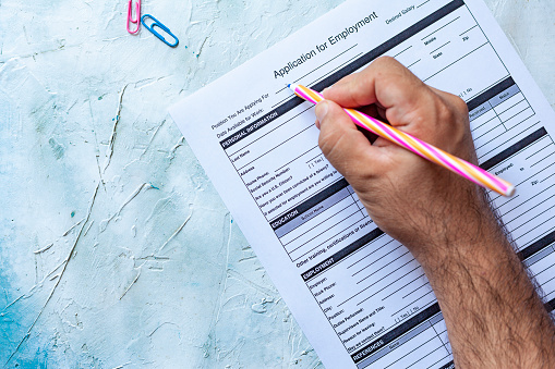 587228412 istock photo Filling application form for job 1164218243