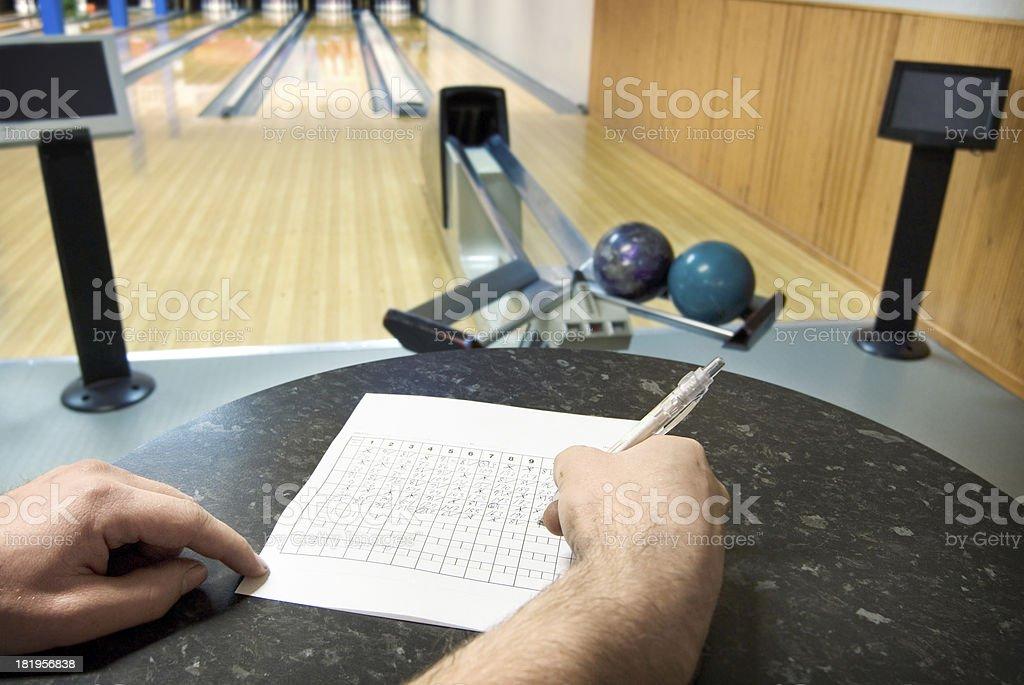Filling bowling scoringcard stock photo