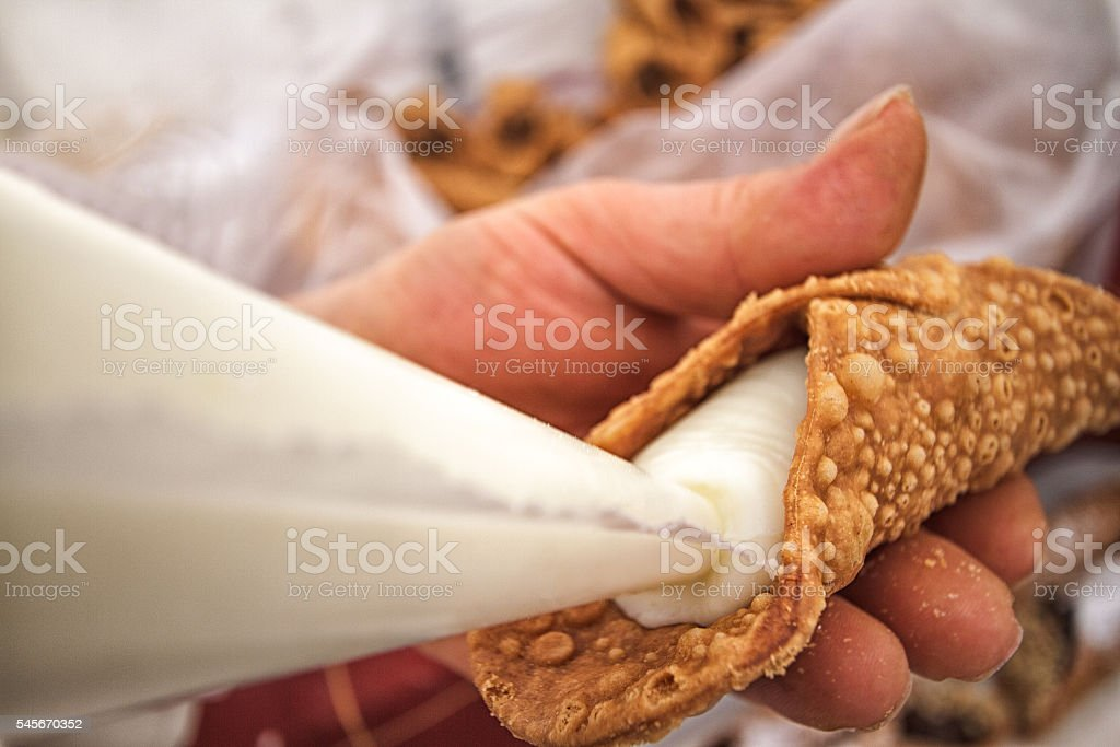Filling Cannoli with Sweet Ricotta from Pasty Bag stock photo