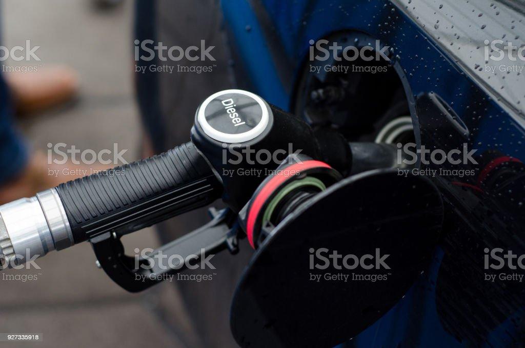 Filling diesel in station stock photo
