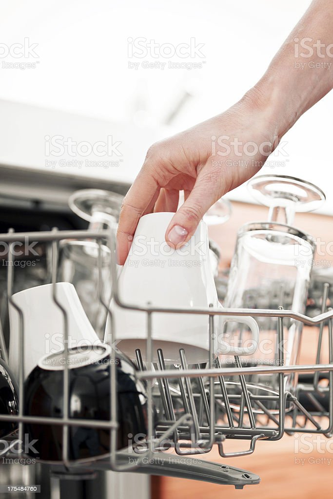 Filling Dishwasher with Cup royalty-free stock photo