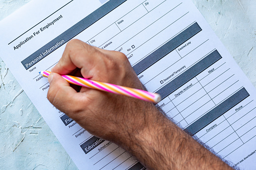 587228412 istock photo Filling employment application form 1164206102