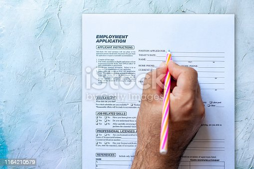 636681940istockphoto Filling employment application form 1164210579