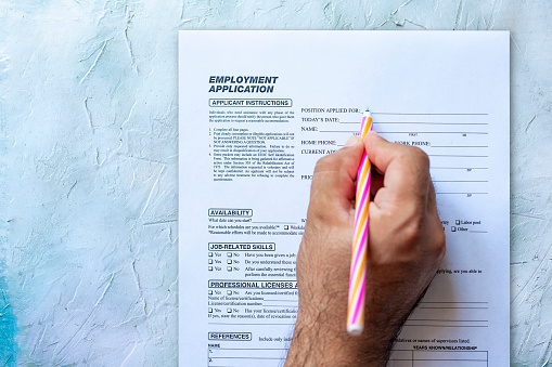 587228412 istock photo Filling employment application form 1164210579