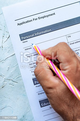 636681940istockphoto Filling employment application form 1164211098