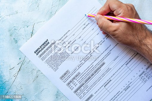 636681940istockphoto Filling employment application form 1164221309