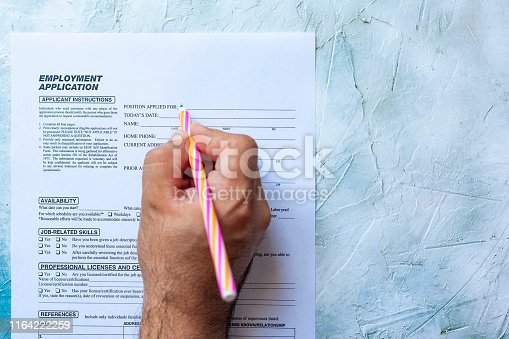 636681940istockphoto Filling employment application form 1164222259