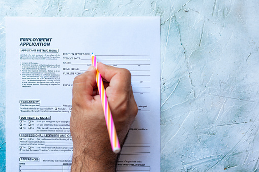 587228412 istock photo Filling employment application form 1164222259