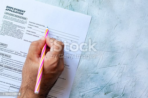 636681940istockphoto Filling employment application form 1164225818