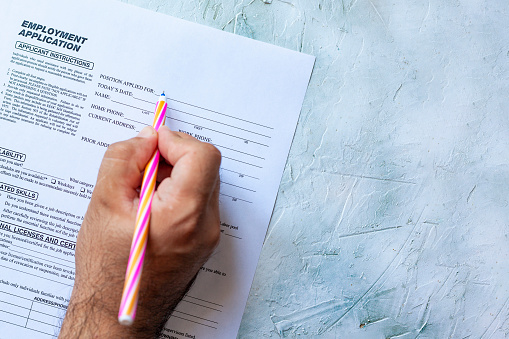 587228412 istock photo Filling employment application form 1164225818