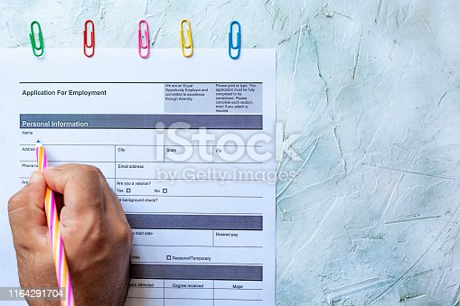 636681940istockphoto Filling employment application form 1164291704
