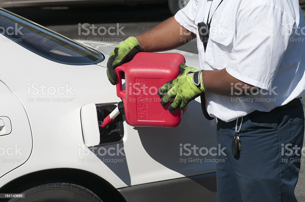 Filling Empty Tank With Gas From 2-Gallon Can stock photo
