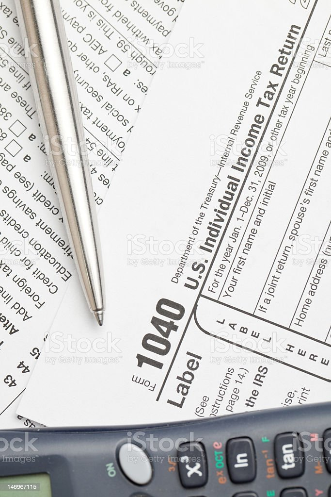 Filling federal individual tax return forms royalty-free stock photo