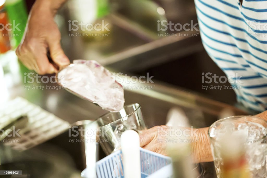 Filling glass with ice in a bar New year's Eve royalty-free stock photo