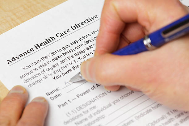 filling in an advance health care directive - advance directive stock pictures, royalty-free photos & images