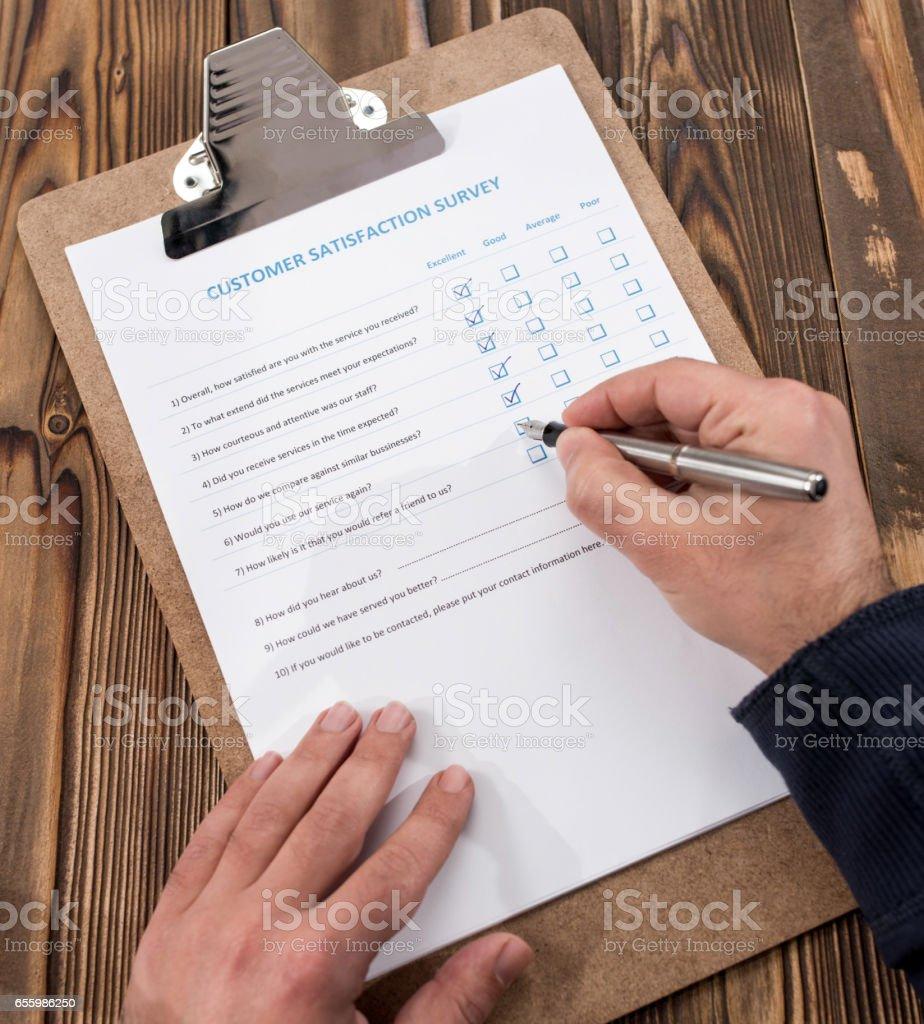 Filling In Customer Satisfaction Survey stock photo