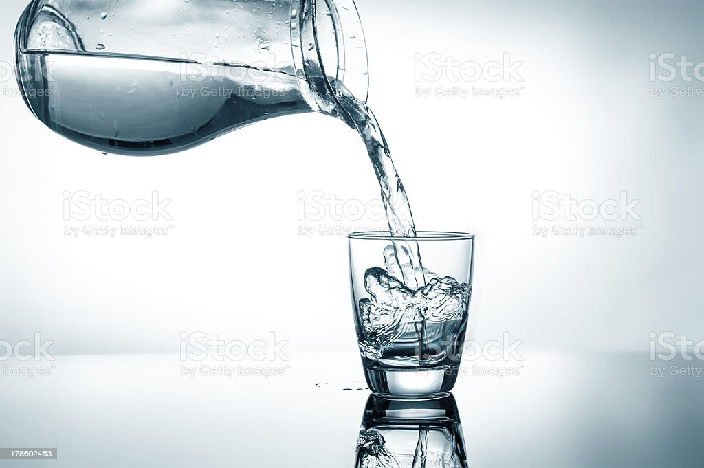Filling in glass of water royalty-free stock photo