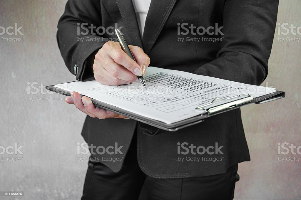 filling in questionnaire stock photo