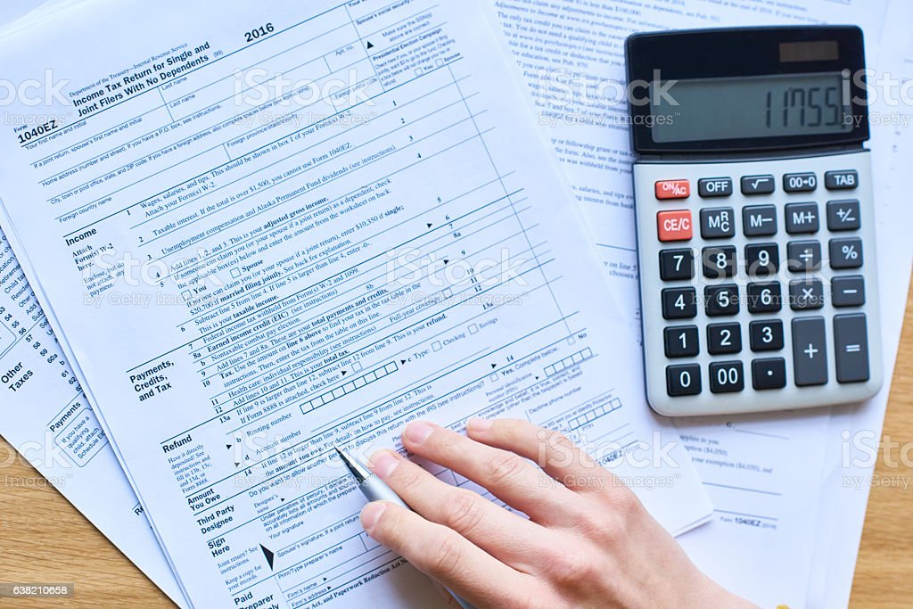 Filling in tax return stock photo