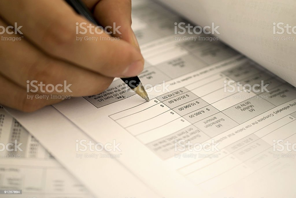 filling in the tax form royalty-free stock photo